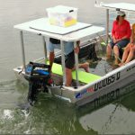 A swamped tinnie is stable to motor ashore