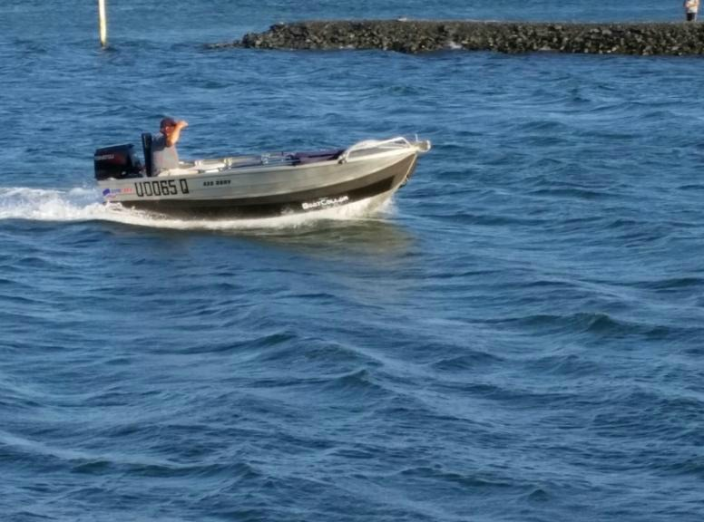 Ranger Geoff in his boat with certified level flotation