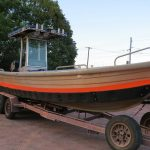 7.3m Better Boat, longboat, Max-66 Collar was painted safety orange on top.