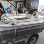 3.5m fibreglass centre console tri-hull with 25hp (little rocket).