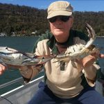 Bob and the crabs they caught in their 3.7m Quintrex Explorer